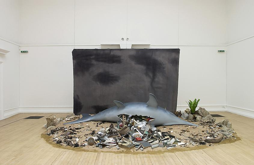 Mark Dion, Ichthyosaurus, 2003. Synthetic Ichthyosaurus, backdrop, misc. obects, sand, rocks. image courtesy of Tanya Bondakdar Gallery.