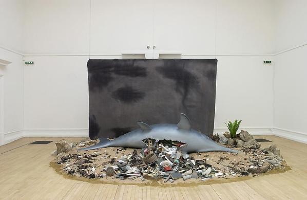 Mark Dion, Ichthyosaurus, 2003. Synthetic Ichthyosaurus, backdrop, misc. obects, sand, rocks. image courtesy of Tanya Bondakdar Gallery.