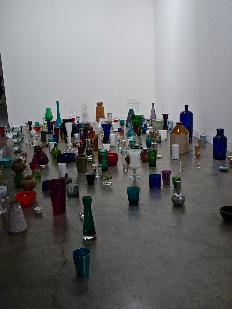 Kris Martin, Water, 2012. glass bottles, water.